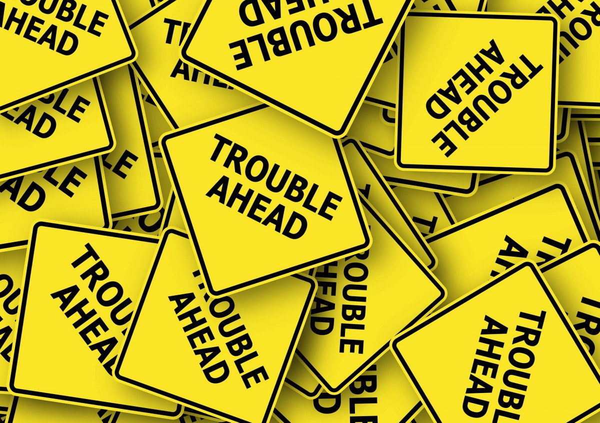 how to handle customer complaints trouble ahead yellow sign